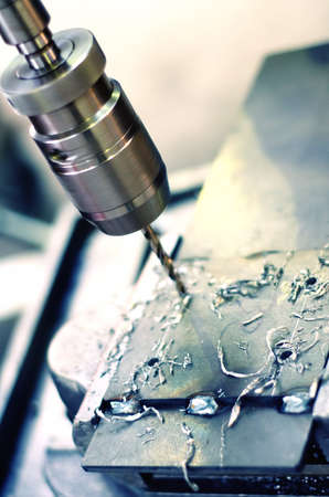 milling: Close-up of an industrial, factory-used drilling machine