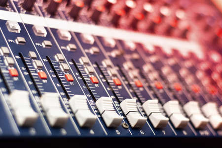 Close-up of music mixer in audio studio photo