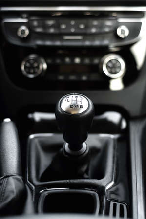 six speed gearstick of modern car against cockpit background photo