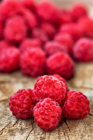 abundant: Fresh, organic raspberry on wood background  Health concept with bio-fruits