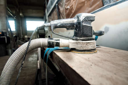 buffing: Power buffer machine used for polishing cars in auto workshop, car service