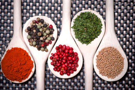 pepper flakes: assortment mix of colorful spices with chopped parsley, mustard seeds, green and red chili pepper Stock Photo