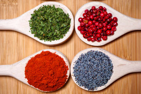 Spicy hot milled pepper, parsely, red peppercorn and poppy seeds as food ingredients  photo