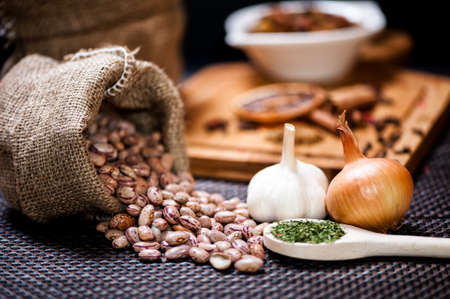 winter ingredients such as bean seeds, onions and garlic or dried hot spicy pepper photo