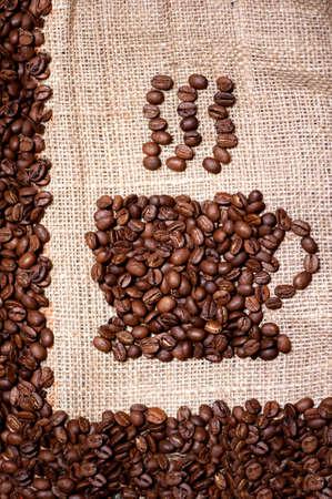 coffee beans mug on sack cloth  photo