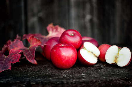 Fresh red, organic apples from autumn harvest. Agriculture harvesting theme with apples on wooden background photo