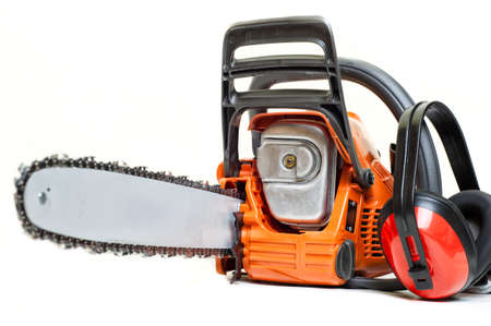 gasoline powered: mechanical gasoline powered chainsaw with protective gear and accesories, isolated on white background