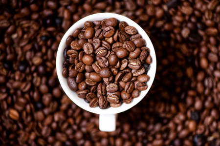 jamoke: African fresh bio coffee beans with cup, detail view from top Stock Photo
