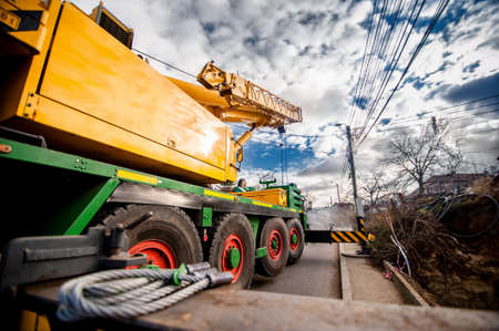 reach truck: industrial heavy duty mobil crane against cloudy and blue sky