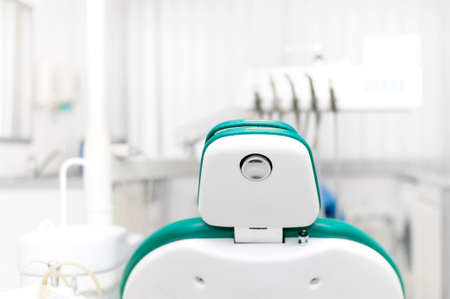Dentist office with tools, professional dentist chair and equipment at local dental clinic photo