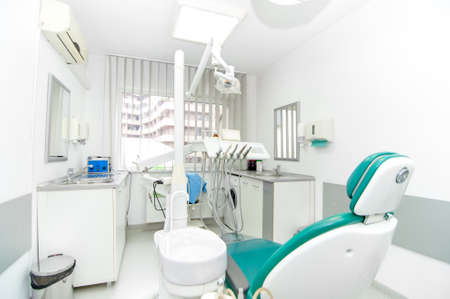 a dentist: dental clinic interior design with working tools and professional equipment  Stock Photo