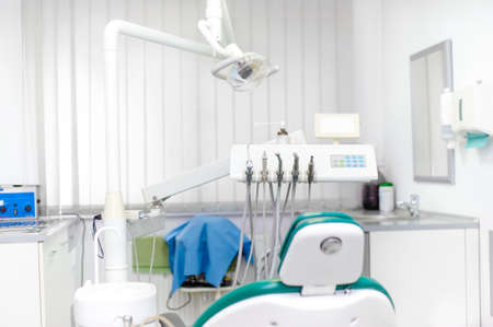 Dentist office interior with tools and dental equipment, dentist chair photo