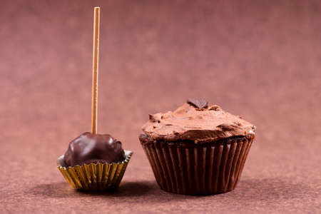 minty: Chocolate muffin with hazelnut minty cream and ice cream topping isolated on brown background
