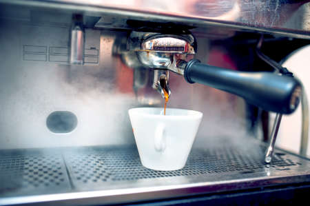 busboy: Espresso coffee machine brewing fresh, bio coffee in restaurant or bar