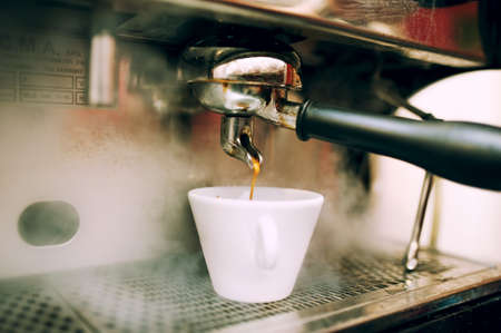 percolate: modern coffee and espresso machine pouring coffee Stock Photo