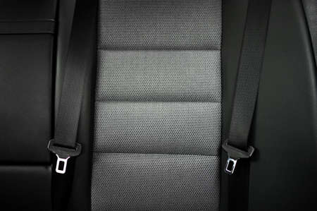 close up safety belt in a rear seat or bench of modern car photo