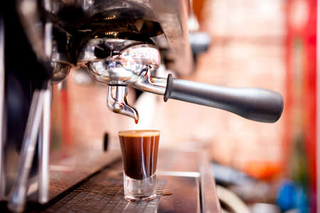 shot: Espresso machine making special strong coffee in shot glass
