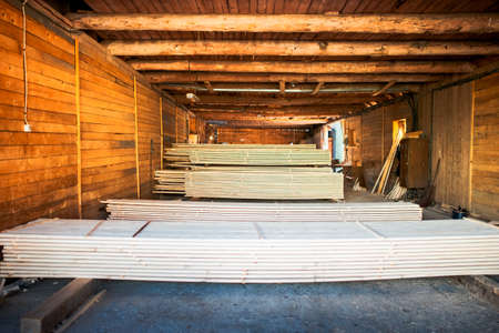 osb: stacks of plywood piled up in wood factory Stock Photo