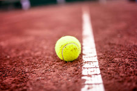 close-up of tennis ball on the clay court photo