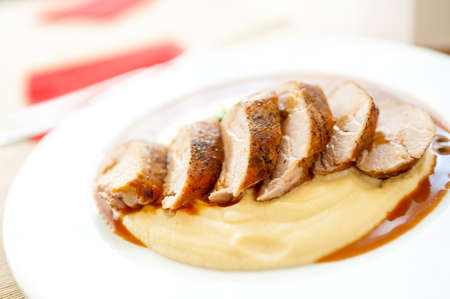 Close-up of grilled pork with mashed potatoes as main course at local restaurant photo