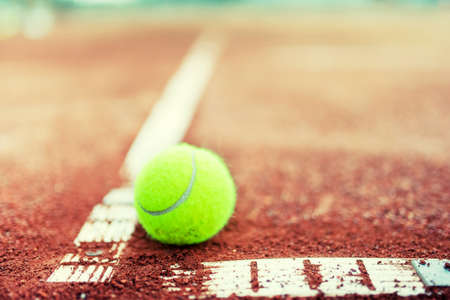 close-up of tennis ball on the court photo