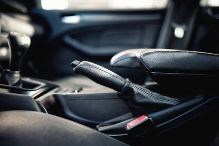 interior modern car elements, close-up of handbrake and seatbelt  photo