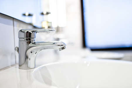 pedestal sink: Contemporary bathroom sink taps and mirrors in luxury home or hotel