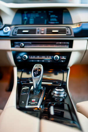 automatic gear shifter in a new, modern car  Car interior with close-up of automatic transmission and cockpit background photo