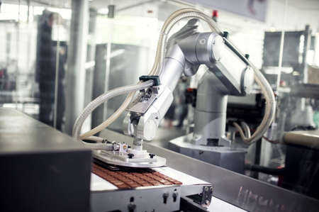 factory automation: Chocolate production line in industrial factory  Automatic process in production line Stock Photo