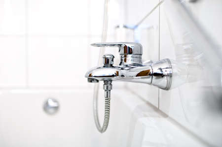 pedestal sink: close up of luxury bathroom tap and bathtub in contemporary home or hotel
