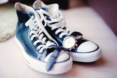 lacing sneakers: Modern wedding with sneakers instead of classic shoes  Still life of groom shoes, watch and accesories