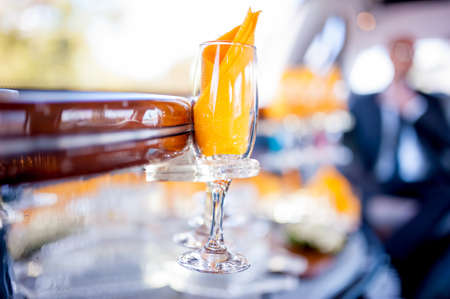 Champagne glass in limousine, wedding day, celebration drinks and elegant event photo