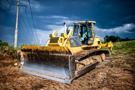 dump truck: industrial backhoe, bulldozer moving earh and sand in sandpit or quarry Stock Photo