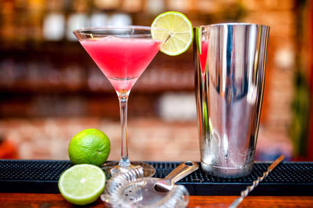 juice bar: cosmopolitan cocktail drink at casino and bar served with lime and ice Stock Photo
