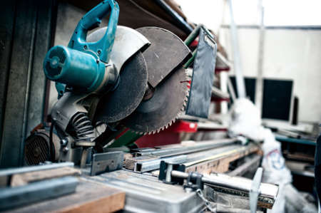 industrial metal cutting tool in factory, sliding compound mitre saw with sharp blade. steel and metal manufacturing photo