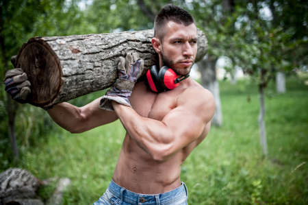 logger: male lumberjack handsome man cutting trees and moving logs around