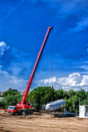 maneuverable: mobile industrial crane installing a concrete and cement production plant Stock Photo