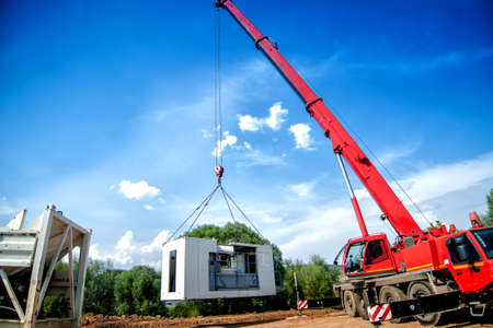 hydraulic lift: big, industrial crane moving a mobile cement plant