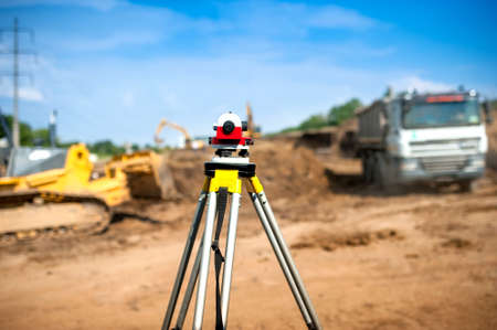 leveling: Surveyor equipment optical level or theodolite at construction site Stock Photo