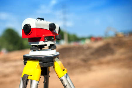leveler: close-up of theodolite measuring system or surveying engineering equipment