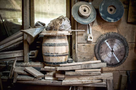 metalwork: old and dusty, vintage workshop of a carpenter with spider web and unused tools