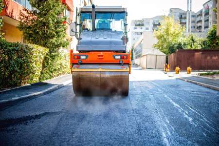 roller compactor: road repairing in urban modern city with heavy vibration roller compactor