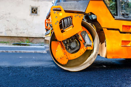 construction vibroroller: Heavy Tandem Vibration roller compactor at asphalt pavement works for road repairing. Stock Photo