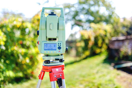cartographer: surveying equipment with transit total station and theodolite with garden background Stock Photo