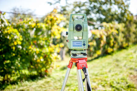 surveying: surveyor engineering equipment with theodolite and total station in a garden at a construction site Stock Photo