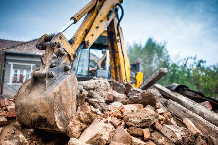 bulldozer: Hydraulic crusher excavator backoe machinery working on site demolition