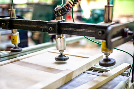 milling machine: Wooden board assembly at wood and furniture factory Stock Photo