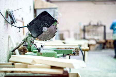 industrial tool in wood and metal factory, compound mitre saw with sharp, circular blade Stock Photo