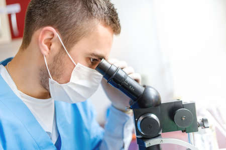 chromatograph: Close-up of man researcher using a microscope, examination of samples in laboratory