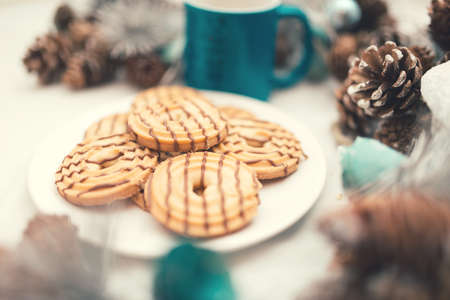 traditional caramel sweets, cookies and biscuits with christmas decoration. vintage effect photo